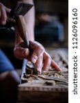 hands of craftsman carve with a ... | Shutterstock . vector #1126096160