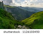 stunning summer mountain... | Shutterstock . vector #1126103450