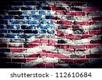 American Flag On Old Brick Wal...