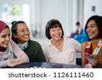 a diverse group of friends chat ... | Shutterstock . vector #1126111460