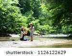 mother and child playing in the ... | Shutterstock . vector #1126122629