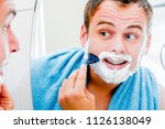 a handsome man in the bathroom... | Shutterstock . vector #1126138049