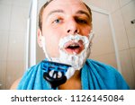 a young man in the bathroom... | Shutterstock . vector #1126145084