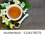 jasmine tea in a white cup with ... | Shutterstock . vector #1126178270