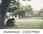 asian woman sitting alone and... | Shutterstock . vector #1126179464