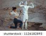 female sculptor creates a... | Shutterstock . vector #1126182893