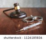 judges gavel and syringe...   Shutterstock . vector #1126185836
