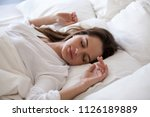 sleeping woman enjoying healthy ... | Shutterstock . vector #1126189889
