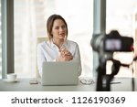 young businesswoman recording... | Shutterstock . vector #1126190369