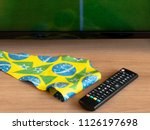 remote control and television... | Shutterstock . vector #1126197698