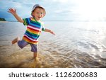 happy boy playing at sea. child ... | Shutterstock . vector #1126200683