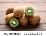 kiwi fruits on brown wooden... | Shutterstock . vector #1126211576