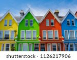 Small photo of colorful houses yellow, green, red and blue in row in Whitehead Northern Ireland