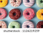 many colorful donuts with... | Shutterstock . vector #1126219259