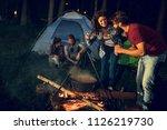 group of friends cooking dinner ... | Shutterstock . vector #1126219730