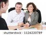 couple sitting in front of the...   Shutterstock . vector #1126220789