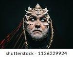 blind wizzard in metalic hood... | Shutterstock . vector #1126229924