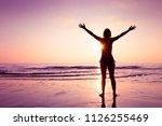 happy joyful woman spreading... | Shutterstock . vector #1126255469