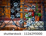 wrought iron gates  ornamental... | Shutterstock . vector #1126295000