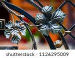 wrought iron gates  ornamental... | Shutterstock . vector #1126295009