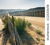 Us mexico border fence near...