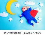 little baby superhero with red... | Shutterstock . vector #1126377509