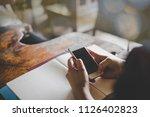 woman reading good news on... | Shutterstock . vector #1126402823