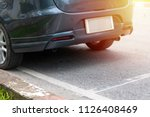 car parking on roadside with... | Shutterstock . vector #1126408469