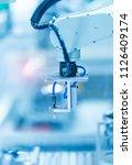 robot with vacuum suckers with... | Shutterstock . vector #1126409174