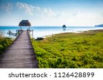 view to the peaceful lake of... | Shutterstock . vector #1126428899