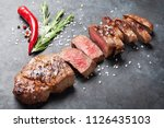 grilled sliced beef steak with... | Shutterstock . vector #1126435103