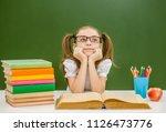 dreamy little girl with books... | Shutterstock . vector #1126473776