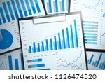 gathering and analyzing... | Shutterstock . vector #1126474520