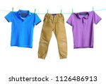 Stock photo child clothes on laundry line against white background 1126486913