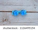 blue sun glasses on natural... | Shutterstock . vector #1126495154
