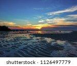 a sunset at walakiri beach ... | Shutterstock . vector #1126497779