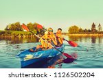 kayaking and canoeing with...   Shutterstock . vector #1126502204