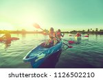 kayaking and canoeing with...   Shutterstock . vector #1126502210