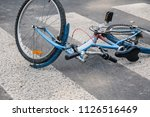 blue child's bicycle lying on a ... | Shutterstock . vector #1126516469