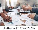 business team colleagues... | Shutterstock . vector #1126528706