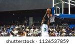 A Basketball Player Throws A...