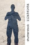 Shadow Of Sportive Man On Sand