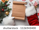 santa claus holding scroll and... | Shutterstock . vector #1126543400
