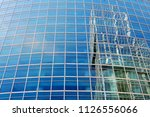 wall of a modern skyscraper... | Shutterstock . vector #1126556066