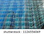 wall of a modern skyscraper... | Shutterstock . vector #1126556069