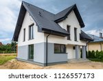 newly built house with a... | Shutterstock . vector #1126557173