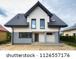 newly built house with a... | Shutterstock . vector #1126557176