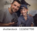 father mechanic with son... | Shutterstock . vector #1126567700