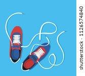 pair of shoes on blue background | Shutterstock .eps vector #1126574840