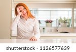redhead woman at kitchen doing... | Shutterstock . vector #1126577639
